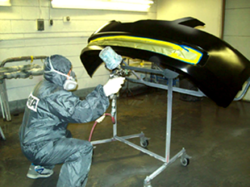 Auto Body Technician Repairing a Bumper